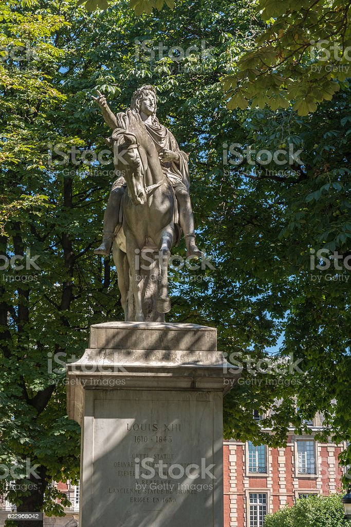 Statue of Louis XIII in Paris stock photo