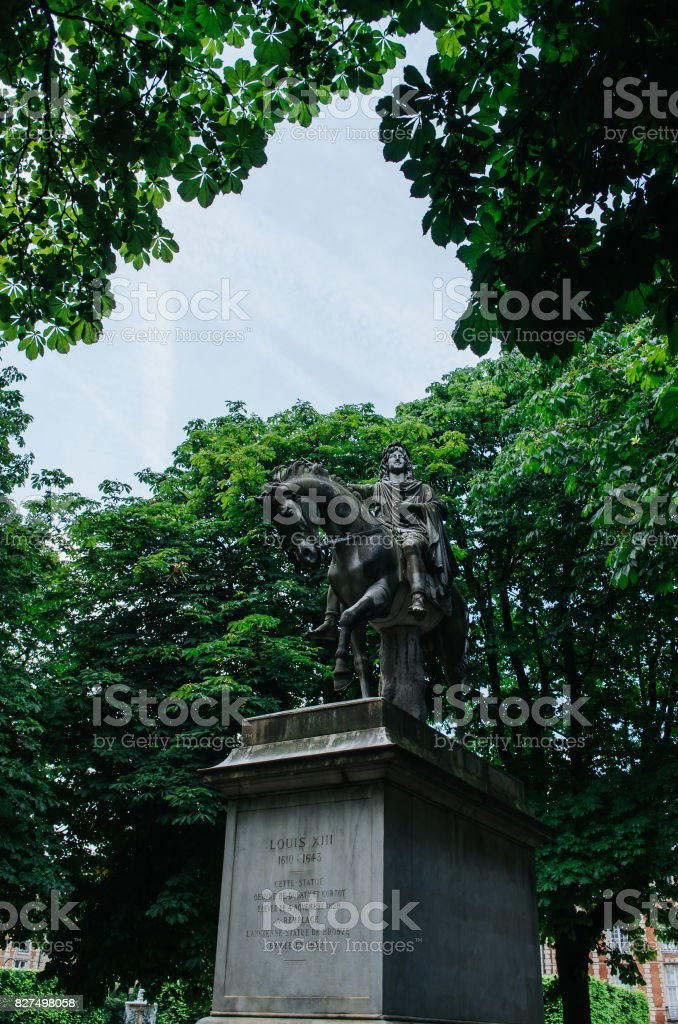 Statue of Louis XIII on the Place des Vosges in Paris, France stock photo
