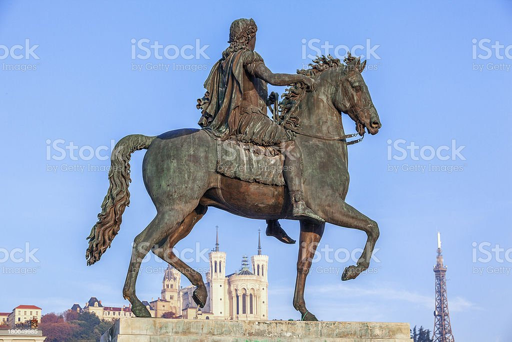 Statue of Louis XIV and Fourviere basilica stock photo