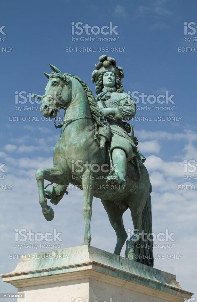 Paris - July 20, 2016:  statue of Louis XIV, Versailles Palace, vertical stock photo