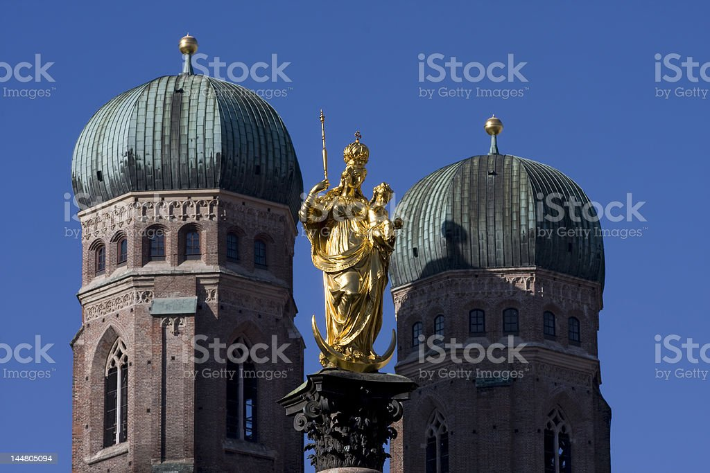Statue of Mary and cathedral royalty-free stock photo