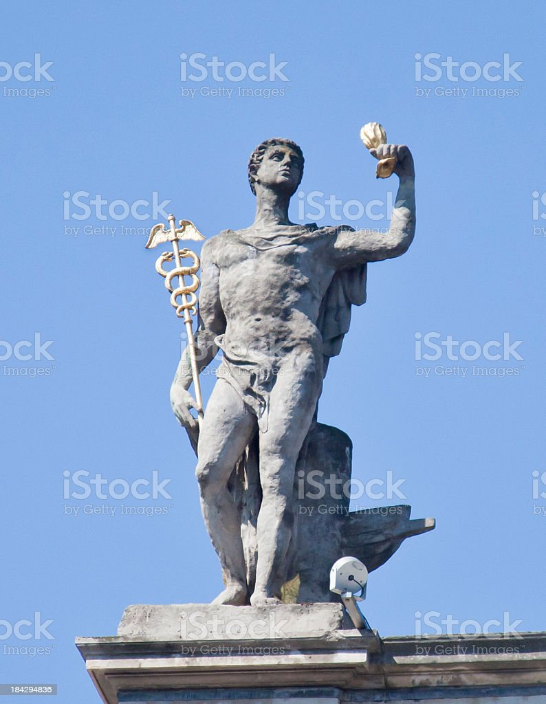 Statue of Mercury with Caduceus and purse stock photo