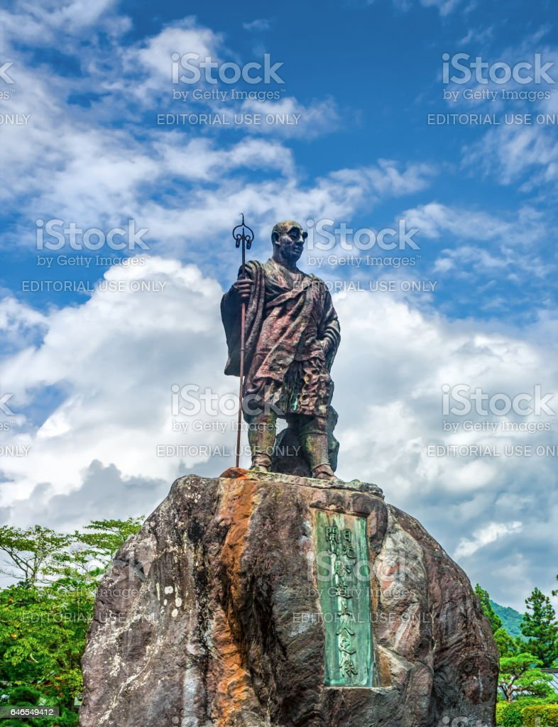 Statue of Monk Shodo Shonin in front of Rinnoji temple with cloudy sky background, Nikko, Tochigi, Japan stock photo