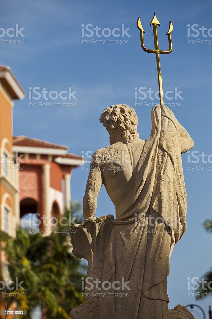 Statue of Neptune at Sunset Naples Florida royalty-free stock photo
