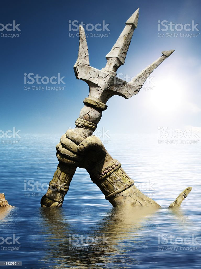 Statue of Neptune or Poseidon's arm holding trident stock photo