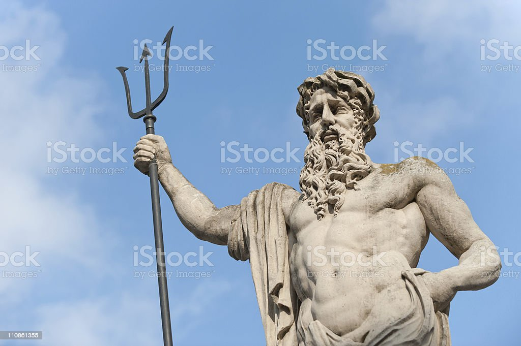 A statue of Neptune with a blue sky and clouds royalty-free stock photo
