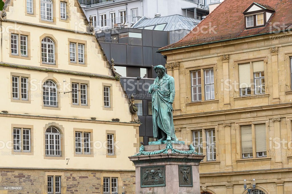Statue of poet Friedrich Schiller with old and new buildings stock photo