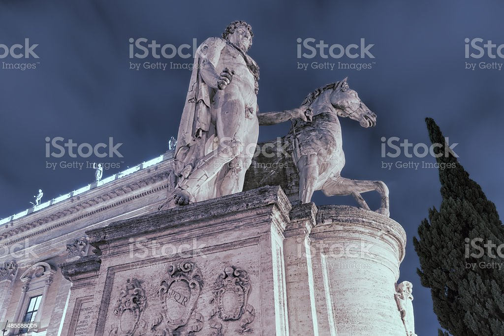Statue of Pollux (the Dioscuri) at night stock photo