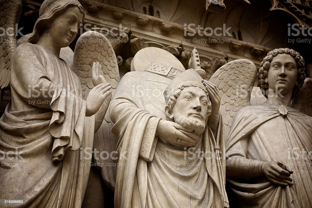 Statue of Saint Denis royalty-free stock photo
