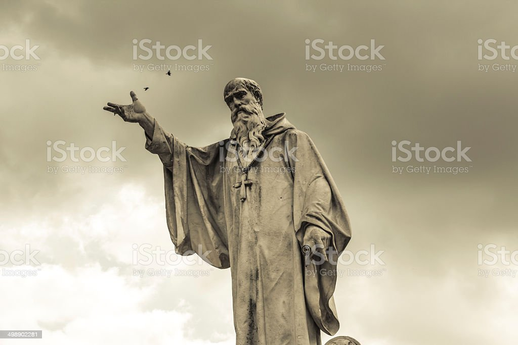 statue of San Benedetto in Norcia stock photo
