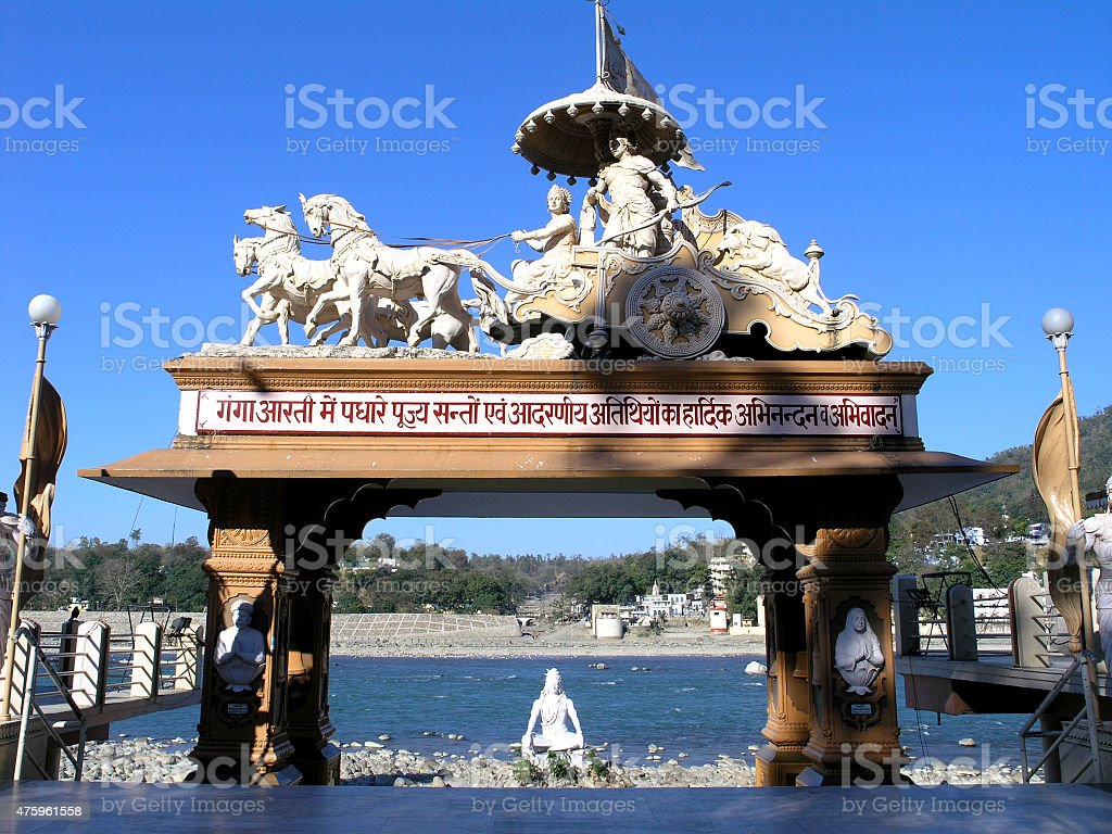Statue of Shiva and Krishna and Arjuna riding a chariot. stock photo