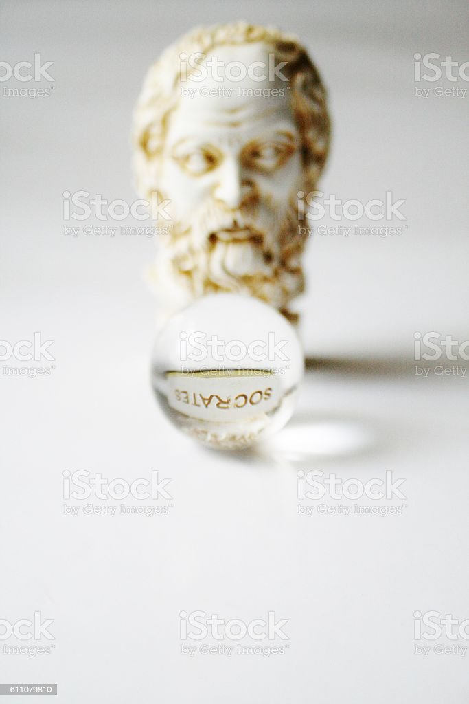 Statue of Socrates with crystal sphere stock photo