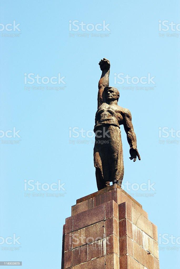 statue of soviet worker stock photo