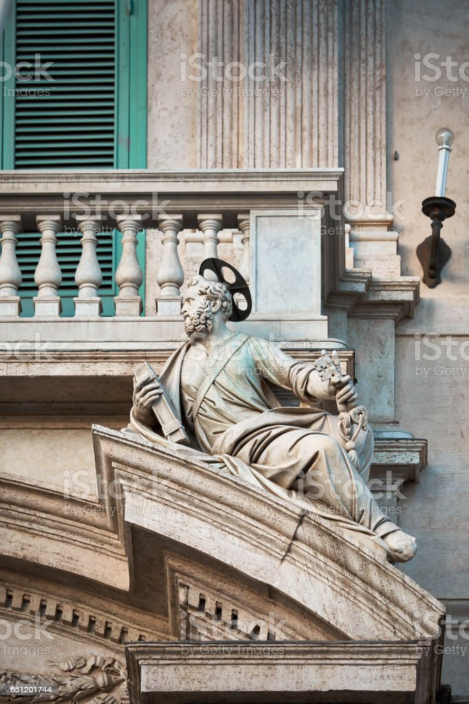 Statue of St. Peter leaning on architectural element from Quirinale palace, Rome Italy stock photo