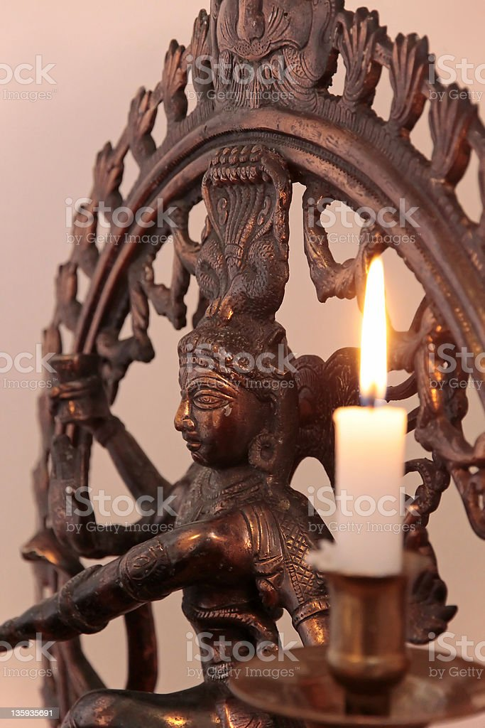 Statue of the goddess Shiva with candle royalty-free stock photo