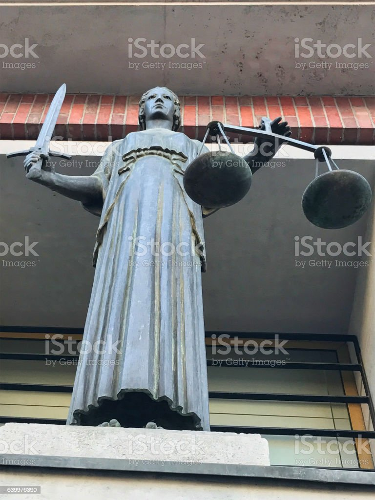 Statue of Themis in court stock photo