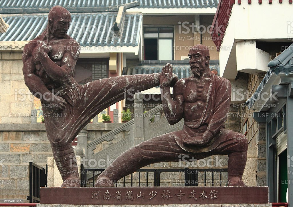 statue of two fighters near Shaolin temple stock photo