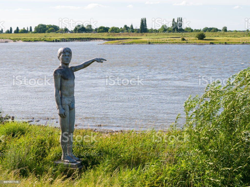 Statue of waterboy on south bank of Waal river, Zaltbommel, Netherlands stock photo