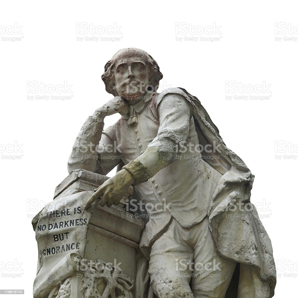 Statue of William Shakespeare leaning on a pile of books stock photo