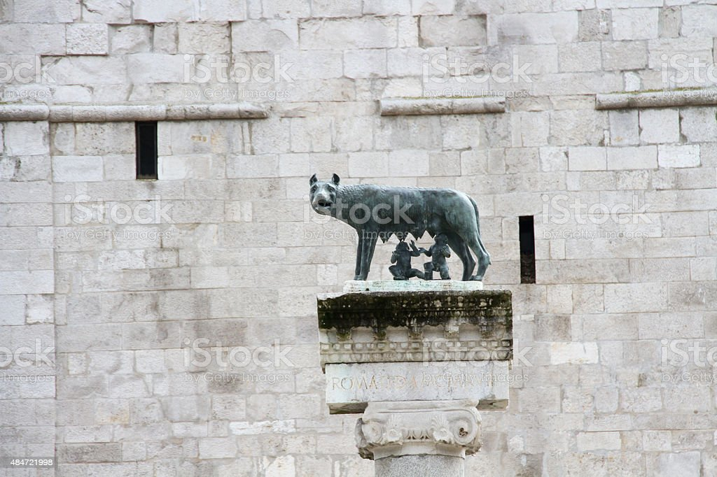 statue of wolf with Remus and Romulus in Aquileia Italy stock photo