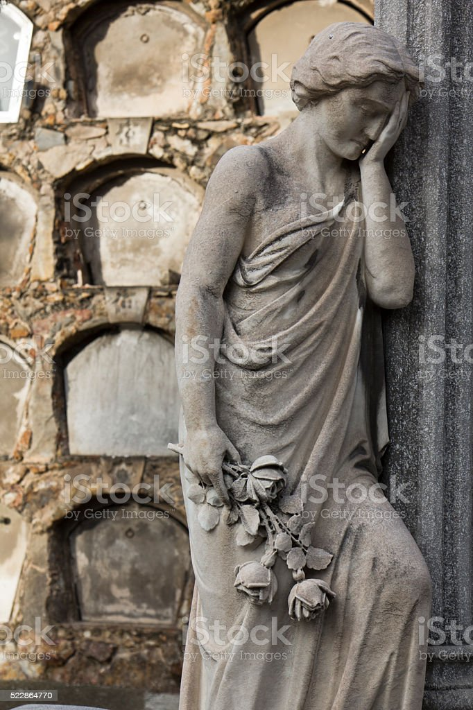 Statue of woman regretting the loss of a beloved one stock photo
