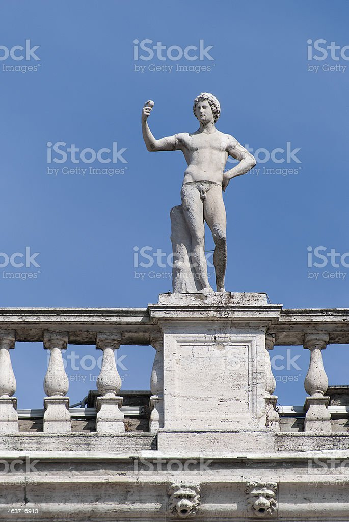 Statue of Young Man with Apple royalty-free stock photo