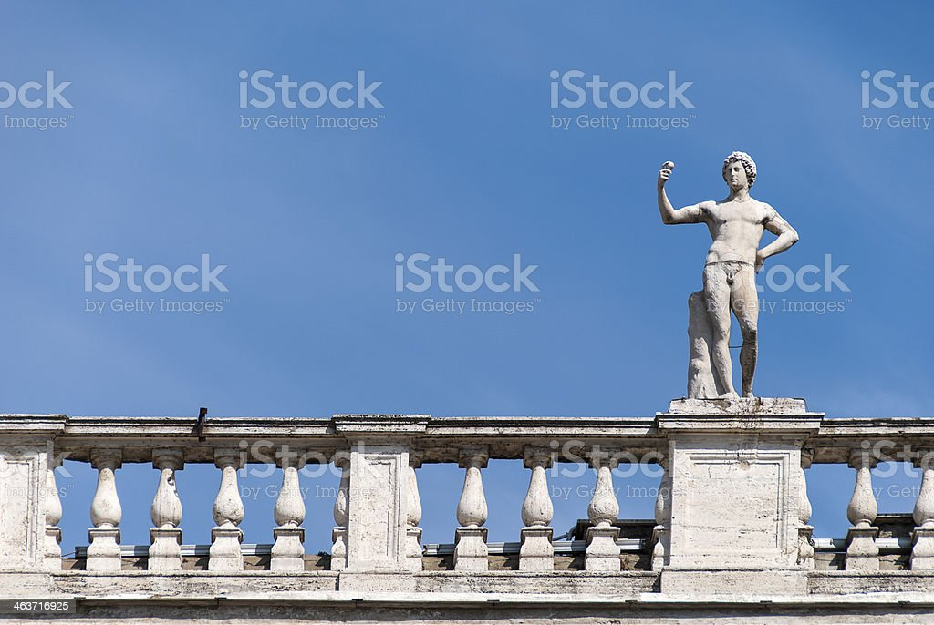Statue of Young Man with Apple stock photo