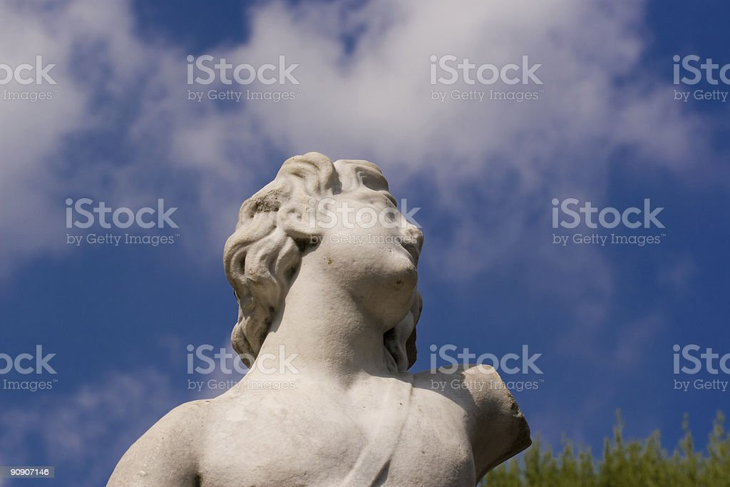 Statue on clouds stock photo