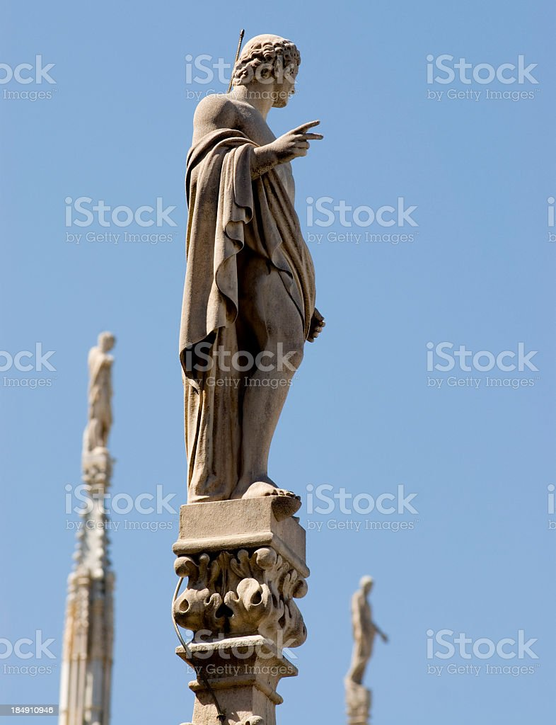 Statue On Duomo in Milan stock photo