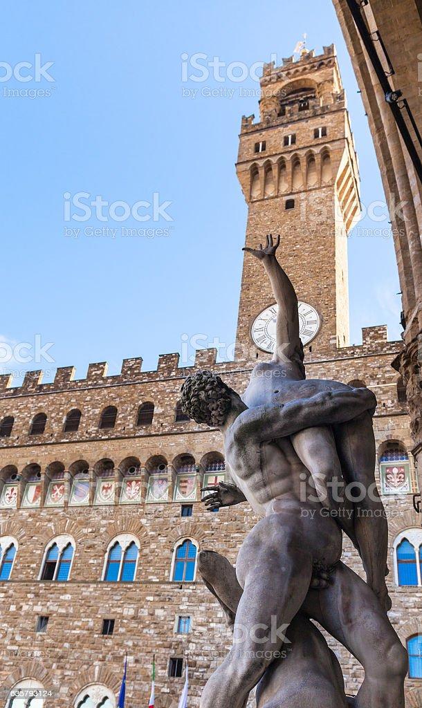 statue Rape of Sabine Women and Palazzo Vecchio stock photo