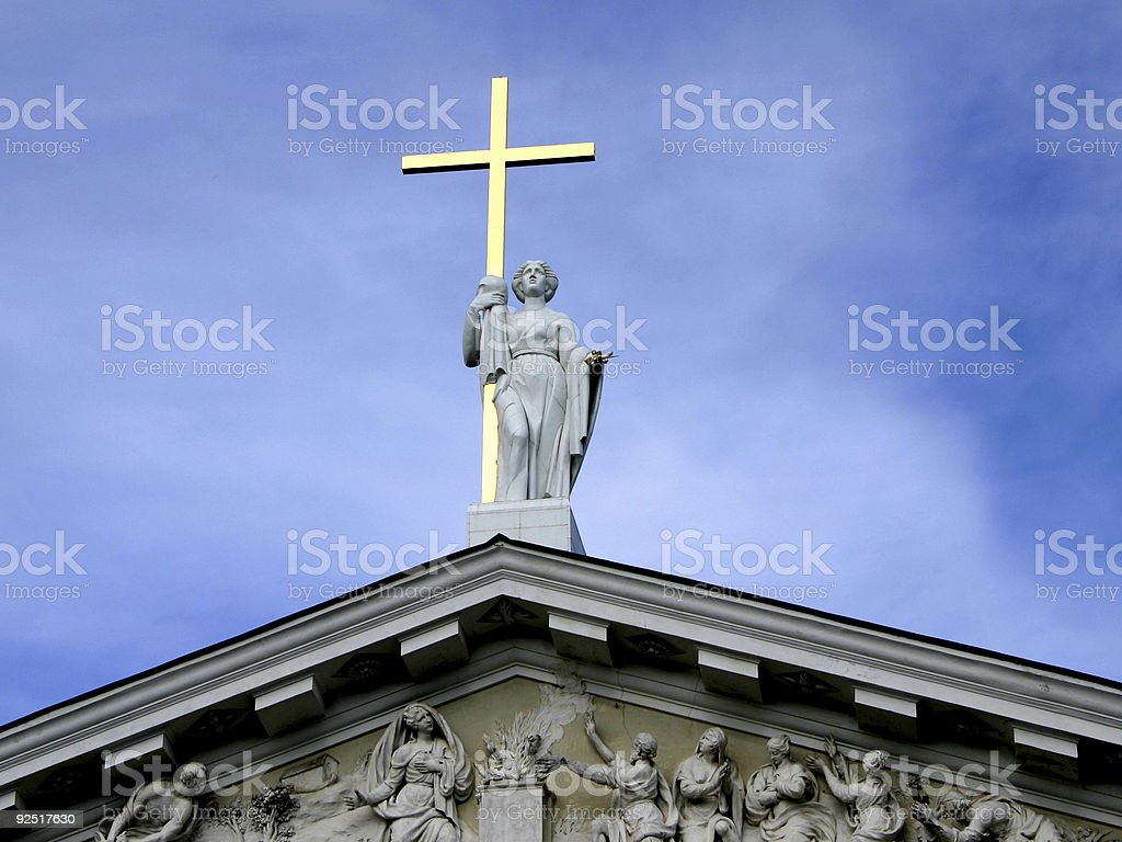 Statue with golden cross royalty-free stock photo