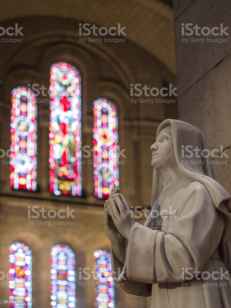 Statue with stained glass window stock photo