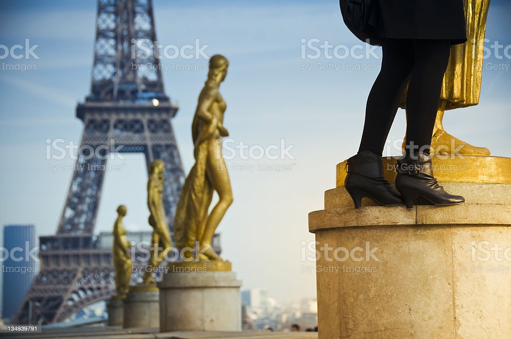 Statues and Eiffel tower stock photo