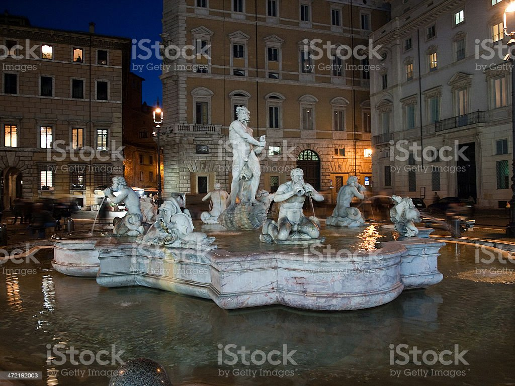 Statues at a fountain stock photo