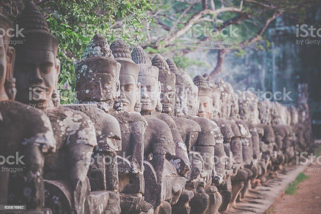 Statues at South gate Angkor Wat, Cambodia stock photo