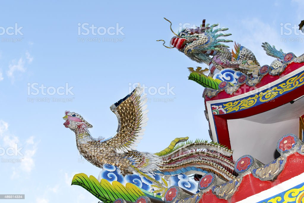 Statues carved dragon and bird on the roof shrine. stock photo