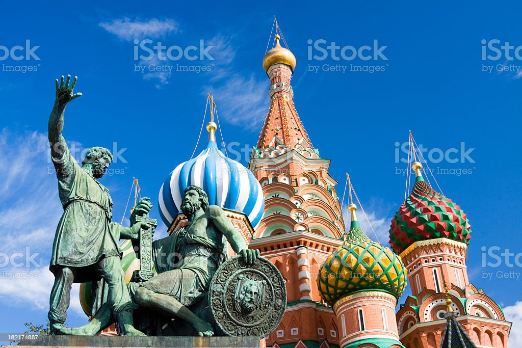 Statues in front of St Basil Cathedral with blue sky stock photo