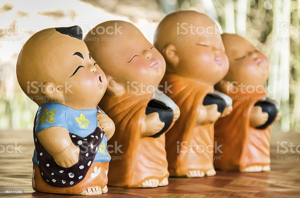 Statues of Baby Buddhist Monks royalty-free stock photo