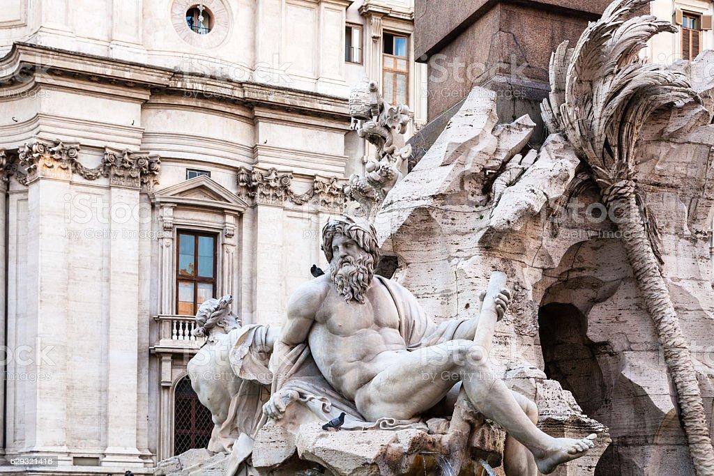 statues of Fontana dei Quattro Fiumi in Rome stock photo