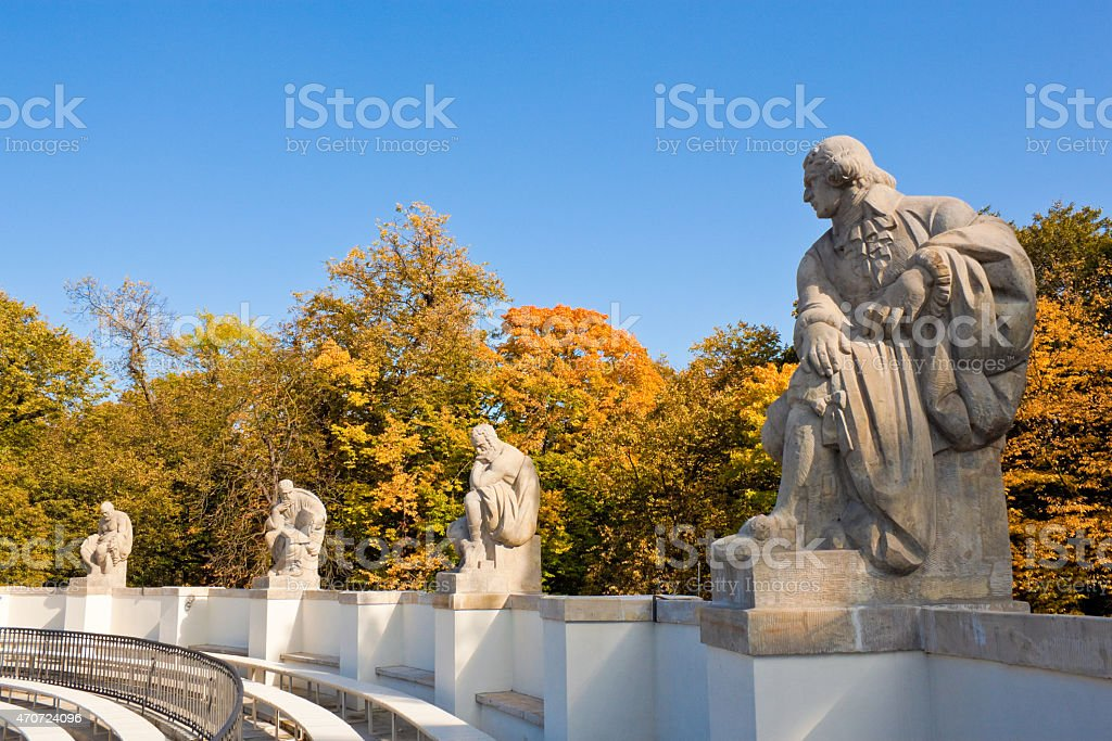 Statues of playwrights in amphitheatre, Royal Baths Park, Warsaw stock photo