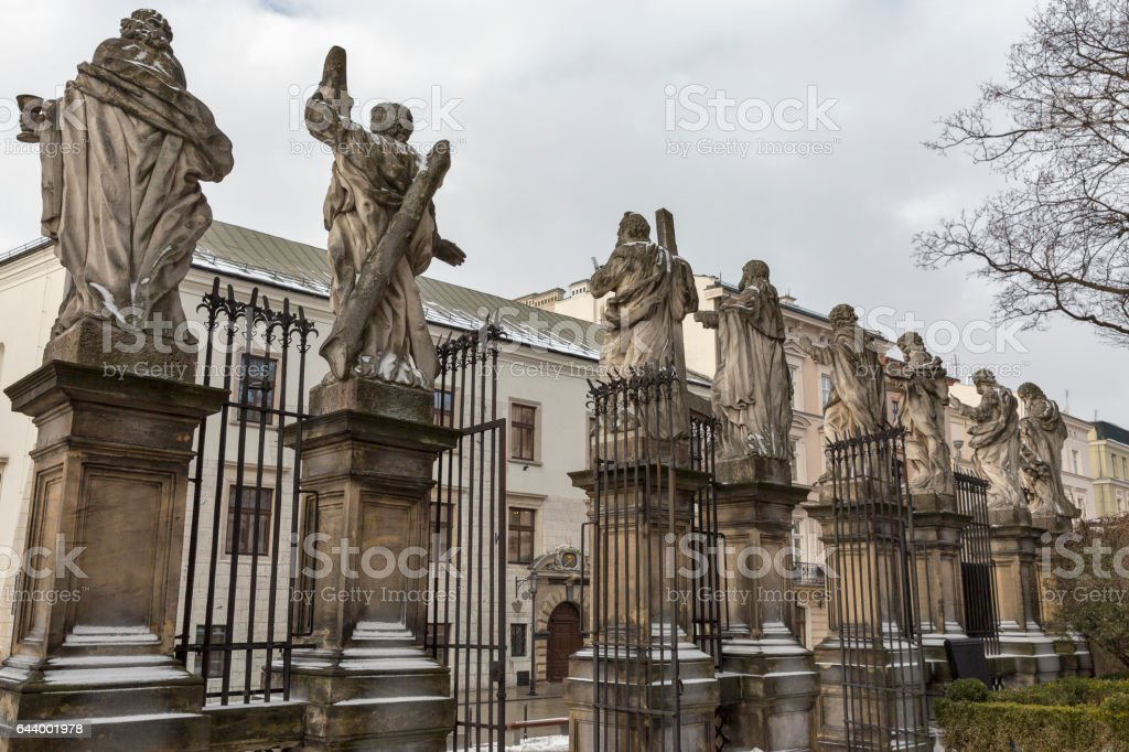 Statues of Saints Peter and Paul Church fence. Krakow, Poland. stock photo