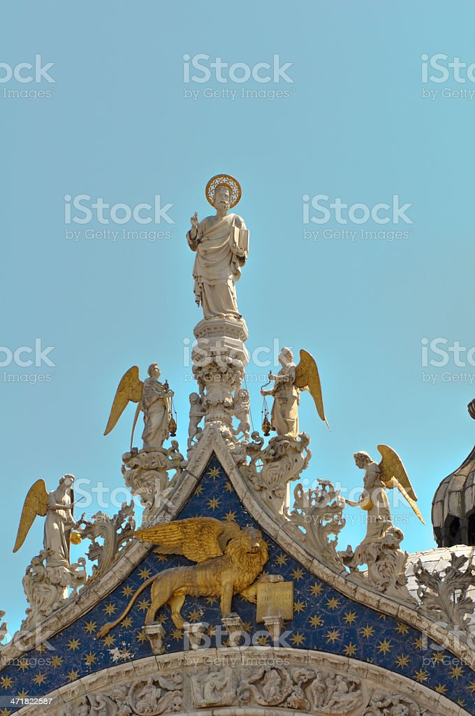 Statues on the top of St. Marco Basilica royalty-free stock photo