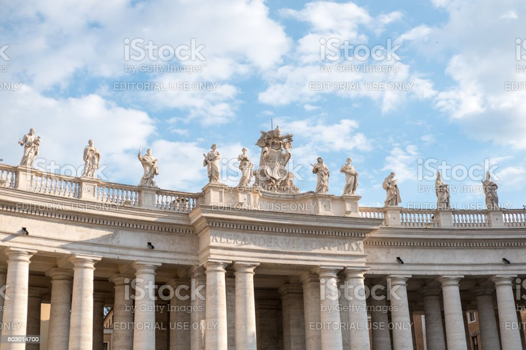 Statues on the top of St Peter's Basilica in Vatican City. stock photo