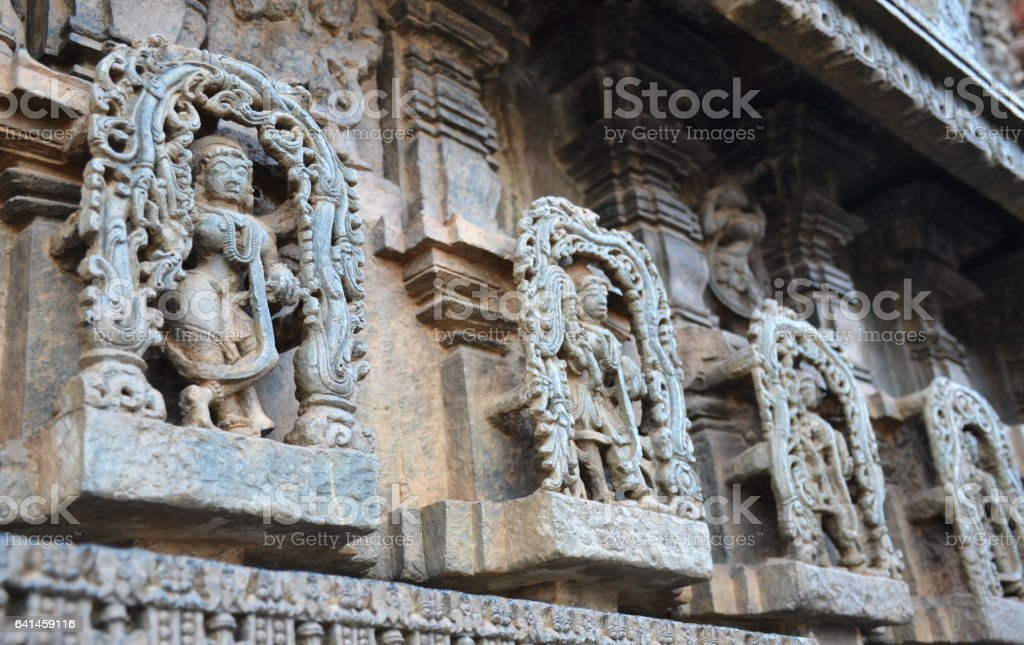 Statues on the walls of Hindu temple stock photo