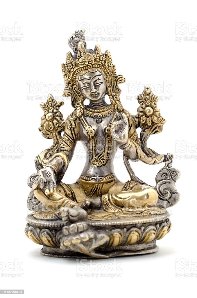 Statuette of Green Tara on a white background. stock photo