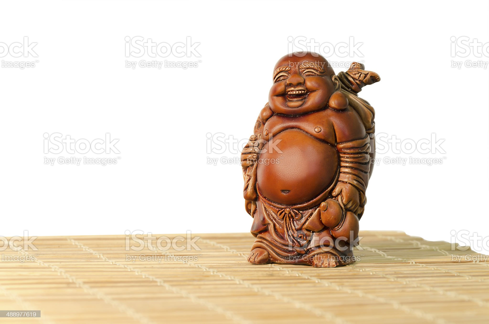 Statuette of laughing Buddha on a white background royalty-free stock photo