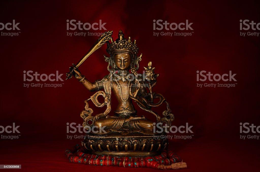 Statuette of Manjushri. stock photo
