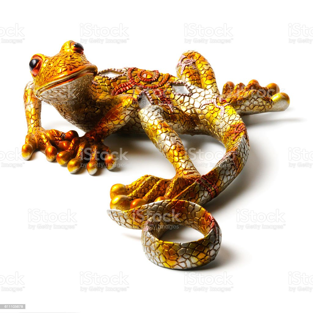 Statuette of the lizard isolated on white background stock photo