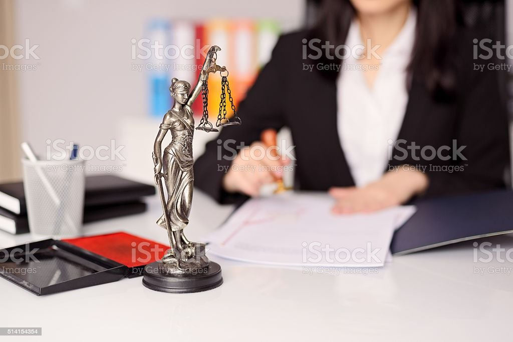Statuette of Themis -  goddess of justice on lawyer's desk stock photo