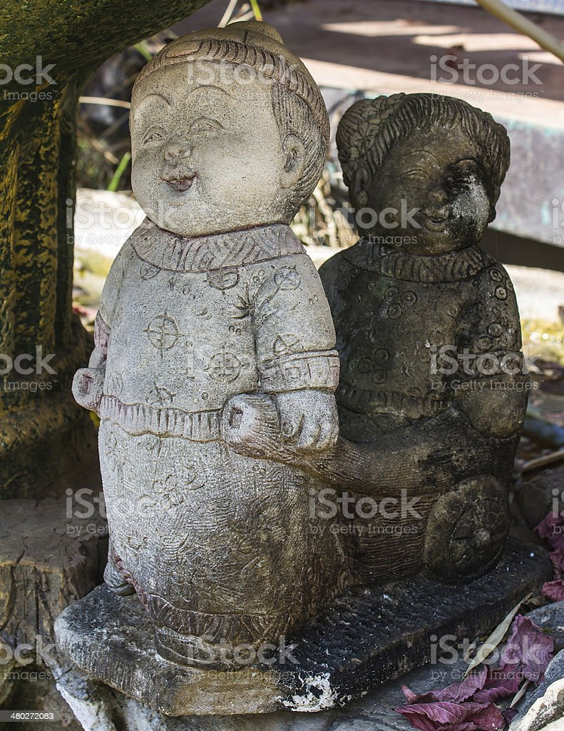 statuettes of funny Chinese boy and a girl stock photo
